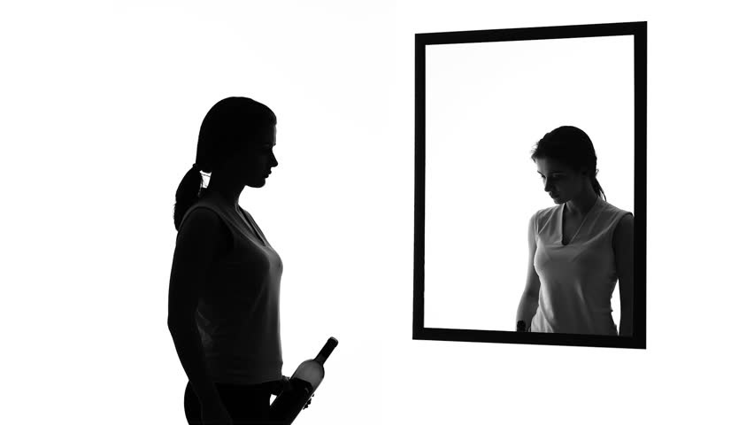 Drunk woman with alcohol bottle looking in mirror, conscience asking to stop