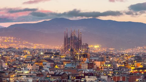 Timelapse aerial view of Barcelona city and sagrada familia skyline at twilight , Spain