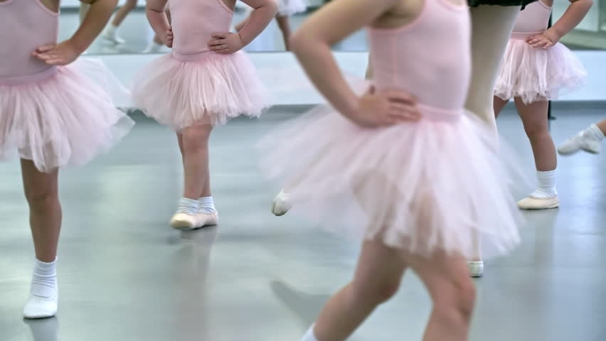 26b8488afeab 4k00 11Legs of unrecognizable little girls doing warm up exercises ...