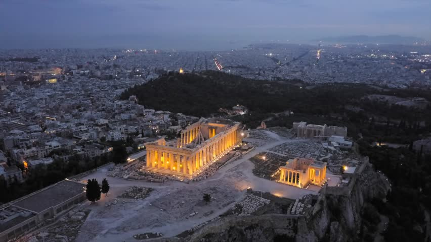 Athens Acropolis and Odeon of Herodes in one 4K drone shot. light up in the evening