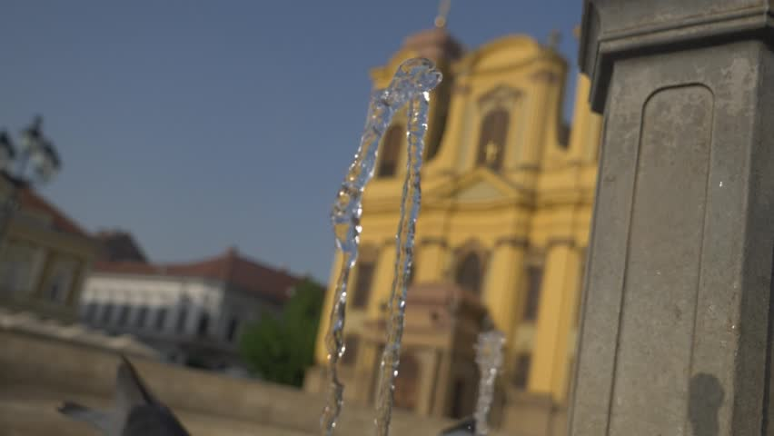 Timisoara union square cathedral in background  and fountain in focus slowmotion