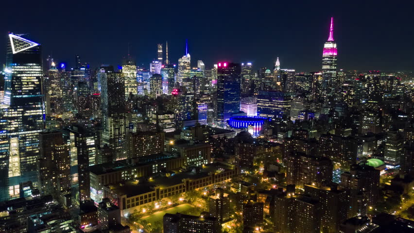 Aerial night view of Manhattan, New York City. Tall buildings. Timelapse dronelapse. NY from above. | Shutterstock HD Video #1012402217