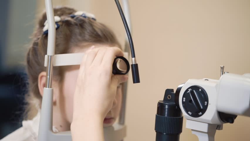the ophthalmologist is engaged Biomicroscopy of an eye, the doctor checks and reveals diseases of the auxiliary apparatus of the organ of vision #1012424357