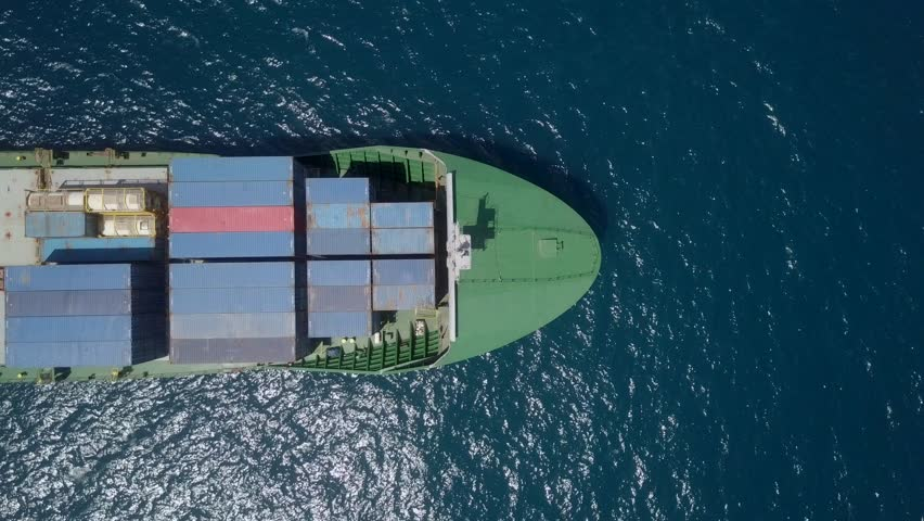 Top down aerial footage of a Medium size container ship at the Mediterranean sea. #1012461257