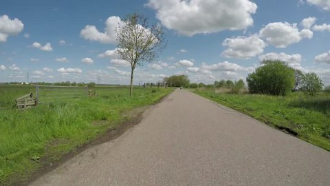 POV Driving backwards on Country road in Dutch polder landscape