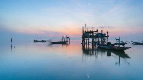 Timelapse of beautiful golden sunrise at fisherman village near charcoal factory in Surabaya, Indonesia.