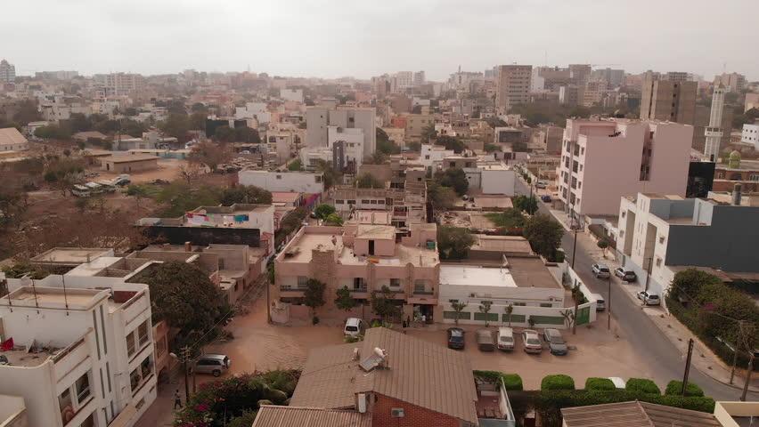 Aerial descending of African city of Dakar, Senegal.