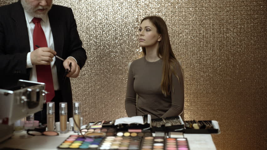 Professional makeup artist showing master classes for makeup. Professional makeup artist working with beautiful young woman.