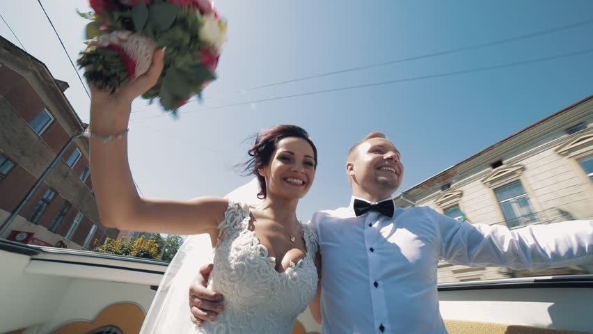 Lovely wedding couple ride with open car roof | Shutterstock HD Video #1012519097