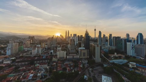 Time lapse: Beautiful Kuala Lumpur city center view during dusk overlooking the city skyline from day to night. Full HD 1080p