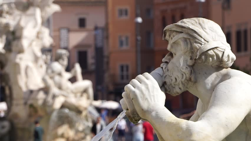 detail of a statue of a fountain in Piazza Navona in Rome in a sunny day