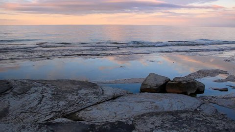 Flat rock famous for ancient fossil imprints on limestones and shales in West Georgian Bay, Craigleigh Provincial Park, The Blue Mountains, Ontario, Canada, at dusk