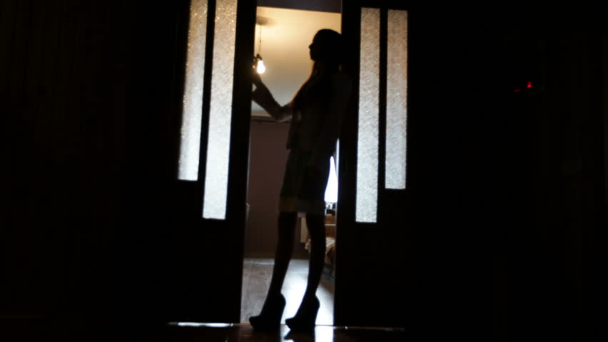 Blurred silhouette of a woman in the room in doorway | Shutterstock HD Video #1012664447