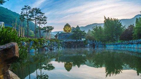 Time lapse Golden head big Buddha statue with body made from stones, The Yunwha Mountain Wowoojongsa or Wawoo Jeongsa Temple Yongin, South Korea