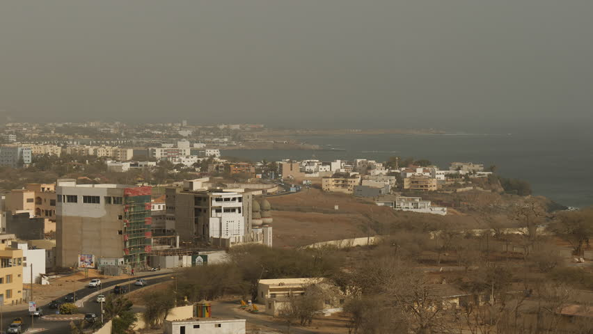 Africa: roads and buildings along the coast of Dakar, Senegal. High angle view.
