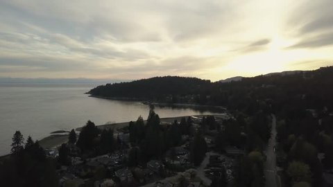 Aerial view of residential neighborhood in West Vancouver, BC, Canada. Taken during a vibrant sunset.