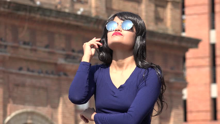 Woman Thinking Wearing Sunglasses And Wig | Shutterstock HD Video #1012701767