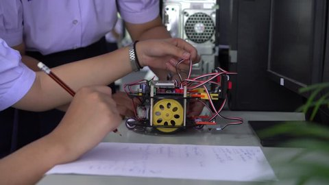 Learning STEM Education robotics project concept: Asian Student group creating and studying for innovation robot model ipst that Study generation for DIY electronic Kit in 21st education classroom