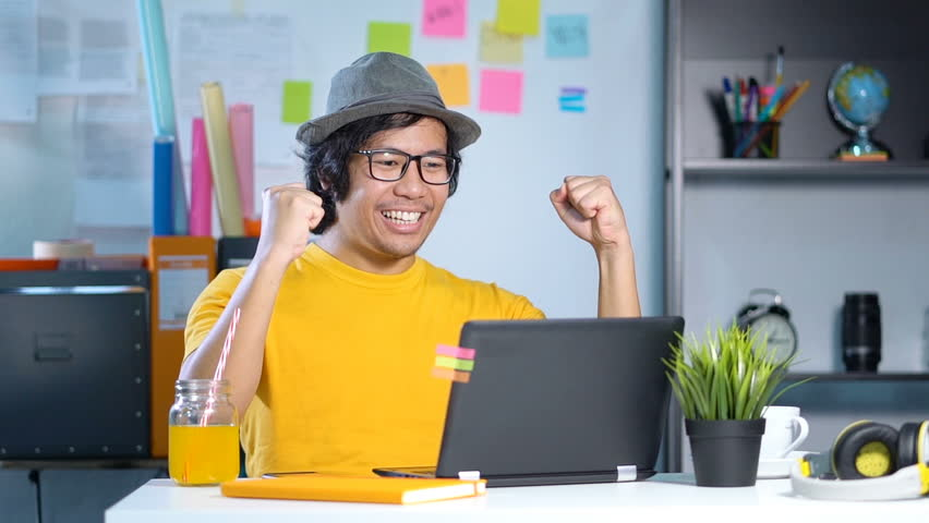 Excited Young Man Feels Satisfied Celebrating Success at Office Slow Motion