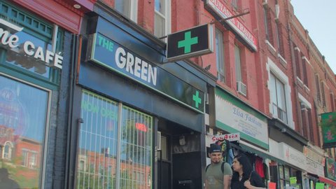MEDICAL MARIJUANA DISPENSARY, TORONTO, CANADA - CIRCA JUNE 2018: Store fronts, shops, and sign closeups of weed dispensaries across Toronto. (For real-time playback re-conform to 60p).