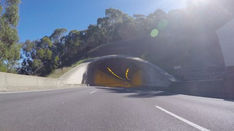 4K vehicle POV driving along freeway to Adelaide, South Australia, driving through tunnel.