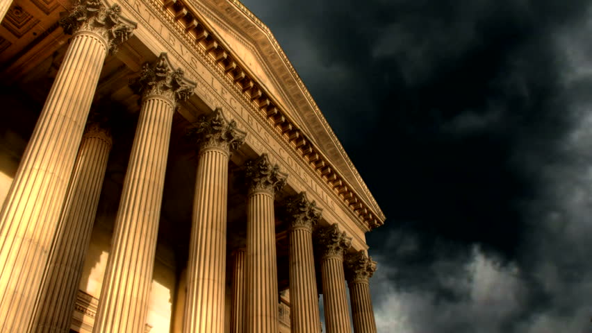 Timelapse clouds over classical building