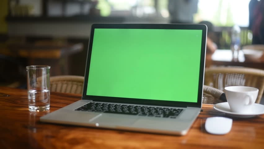 A laptop computer with a key green screen set on coffee shop. | Shutterstock HD Video #1012807247