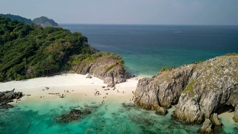Aerial view of beautiful white sand beach and snorkel point at Cockburn island in Andaman sea near Ranong Thailand, Myanmar (Photo from Drone)