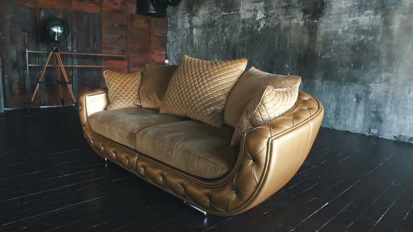 Elegant saturated glossy gold leather texture of sofa chair, Brown leather background