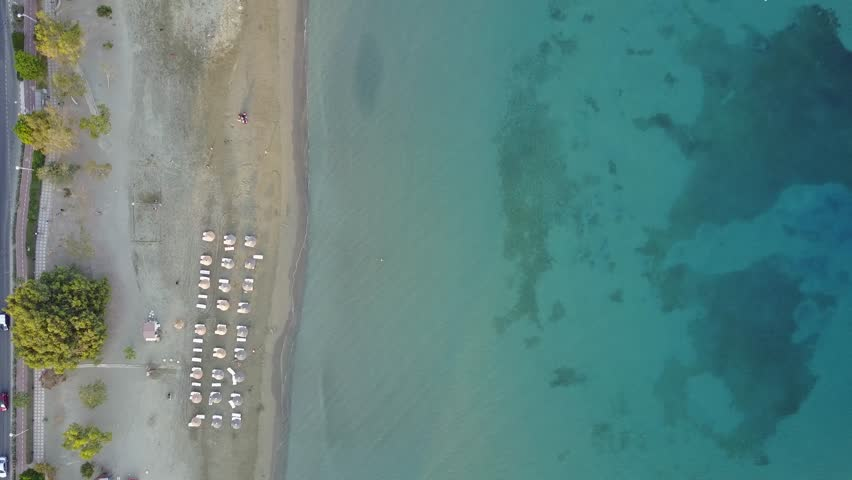 Wide aerial view looking down on a beach and boating area in Limassol, Cyprus