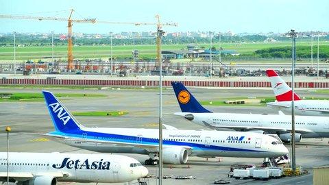 BANGKOK-JUNE 29, 2018:Docked away flights in Suvarnabhumi Airport. Suvarnabhumi Airport is one of two international airports serving Bangkok, Thailand.