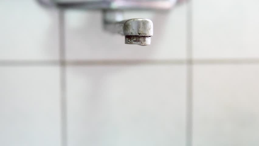 Faucet with water in the bathroom.Water drop. Slow Motion 120 fps. | Shutterstock HD Video #1012991987