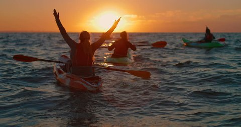 a beautiful dawn in the sea on kayaks. in slow motion