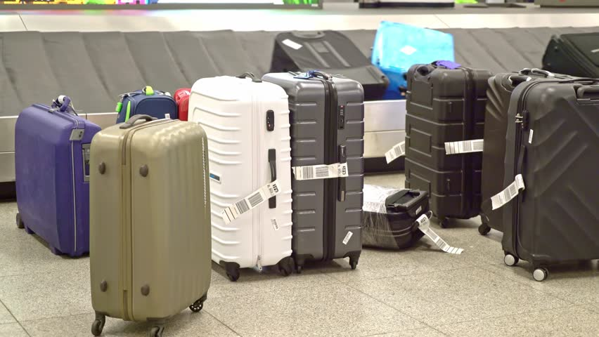New York, United States, June 10, 2018: Luggage on baggage carousel waiting for travelors at the depature hall of John F. Kennedy airport