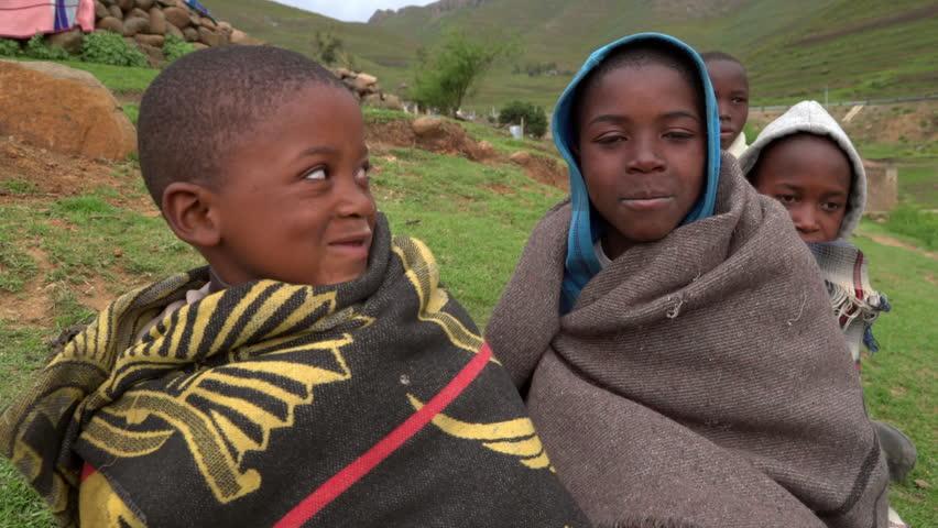 Group shot of african herd boys in rural landscape .Lesotho,circa November 2016 | Shutterstock HD Video #1013094947