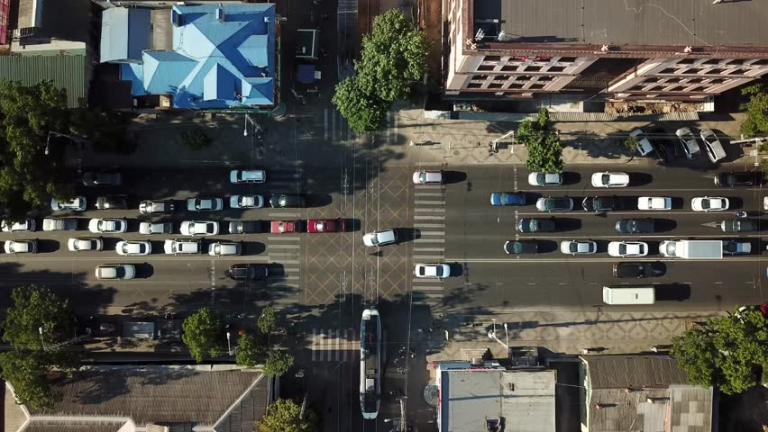 Abstract aerial drone footage of rooftops and streets in the center of Krasnodar city, Russia. Traffic congestion rush hour. | Shutterstock HD Video #1013107787