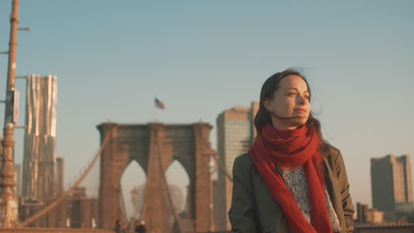 Young attractive woman walking on the Brooklyn Bridge | Shutterstock HD Video #1013146577