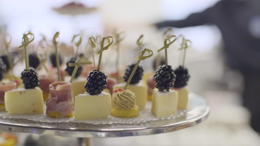 Many tasyty canapes with cheese and berries selective focus