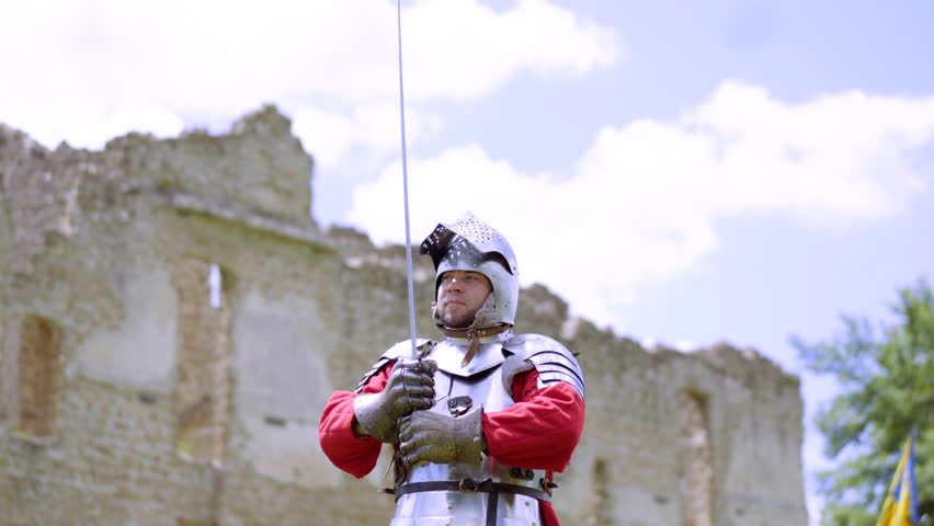 Old Knights in armor, medieval warrior preparing for battle, historical reenactment | Shutterstock HD Video #1013186447
