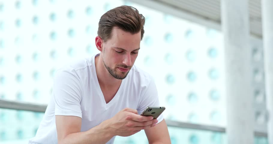Young man sending sms on cellphone | Shutterstock HD Video #1013200547