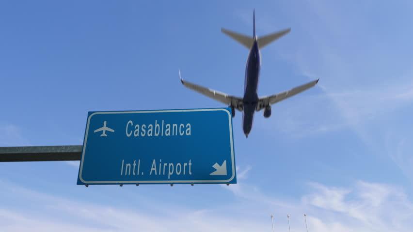 Casablanca airport sign airplane passing overhead