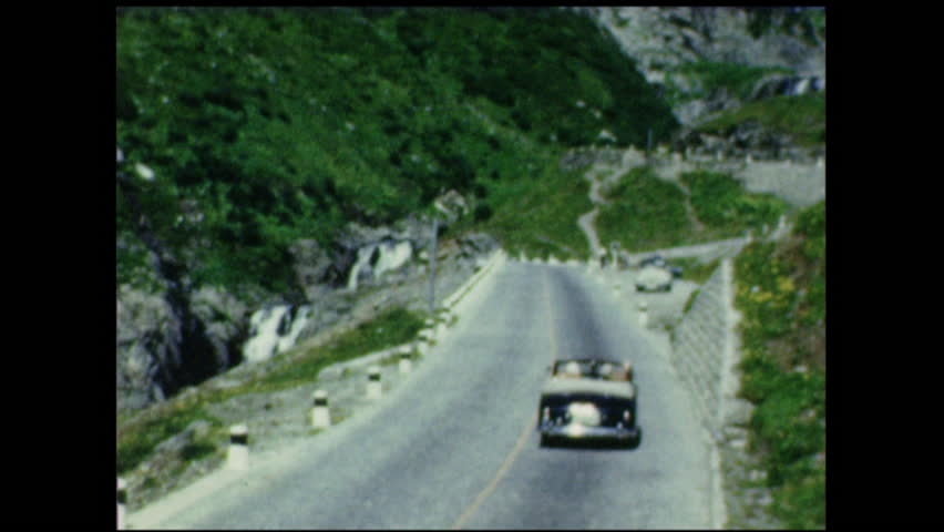 Brenner Pass with traffic, Europe 1950's. 8mm vintage home movies. #1013224607