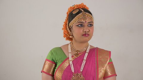 Indian girl showing different moods using traditional Bharat Natyam dance form. Worried expression.