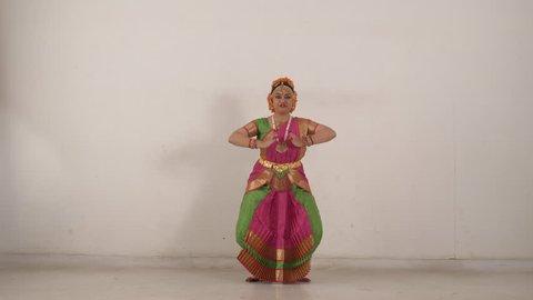 Indian girl performing traditional Bharat Natyam.