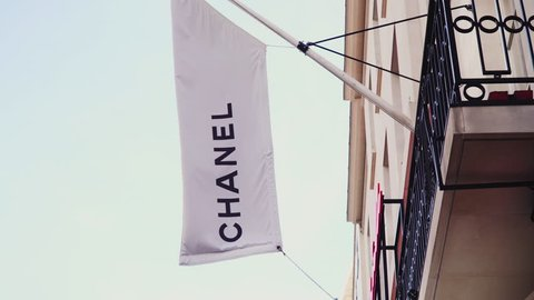 LONDON UK - MAY 26, 2018. A front sign flag exterior view of the Chanel store on New Bond street, London