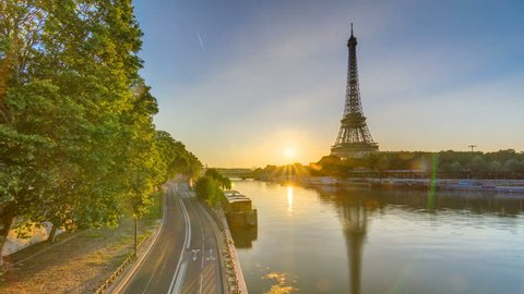 Eiffel Tower And The Seine River At Sunrise Timelapse Paris France Morning View From Bir Hakeim Bridge With Reflections On Water And Traffic On The Street