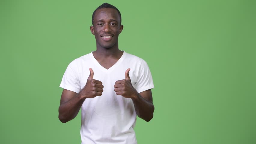 Young happy African man smiling while giving thumbs up | Shutterstock HD Video #1013379887