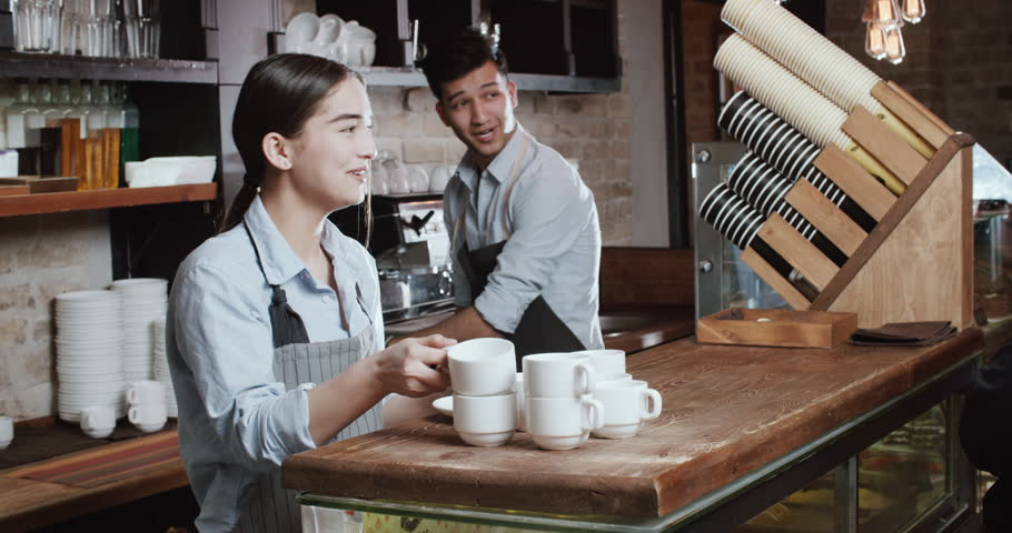 Young happy asian couple working in their new cafe. Family business concept 4k