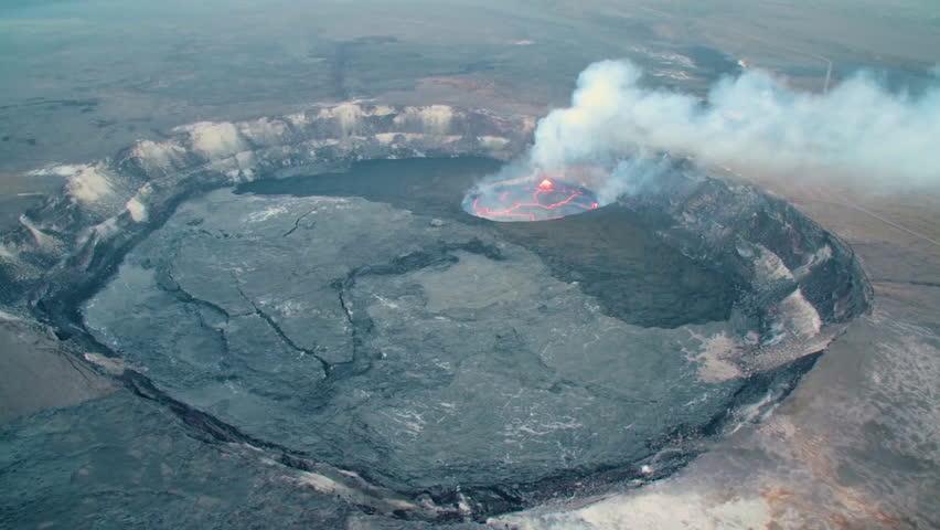 CIRCA 2018 - Amazing aerial shot over the Summit Vent Lava lake on Kilauea volcano erupting, Hawaii.