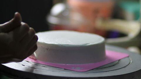 Bakery chef decorate cake with cream. Concept cafe and bakery, bakery business and industry, how to making a cake